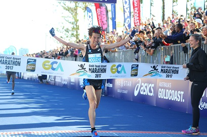 Gold Coast Marathon men's winner crosses the finish line