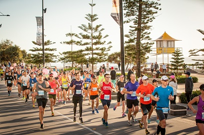 Participants running through Surfers Paradise