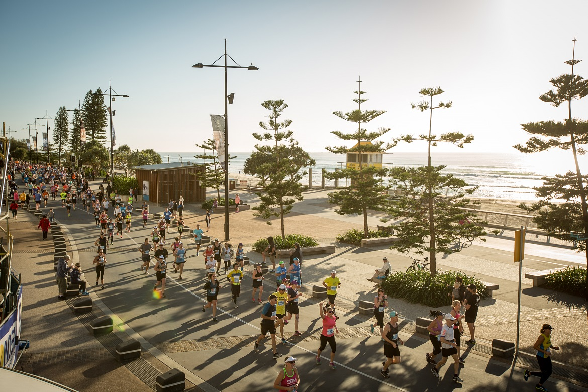 Marathon participants run through Surfers Paradise