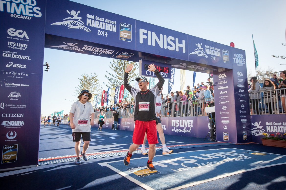 Participants crossing the 5.7km Challenge finish line