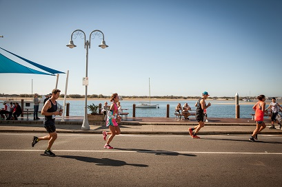 Participants run alongside the broadwater