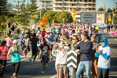 Spectators cheers on runners on the Gold Coast
