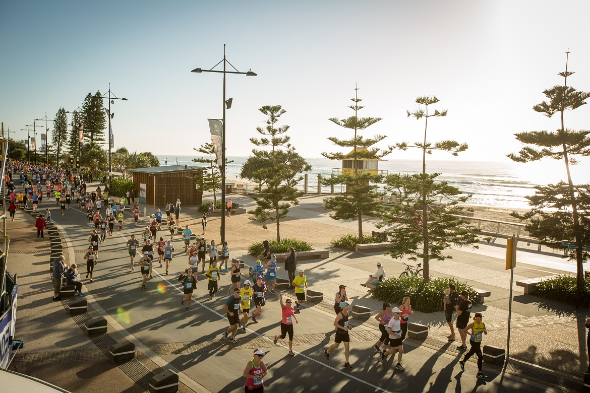 Participants run through Surfers Paradise
