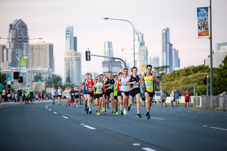 Runners crossing bridge